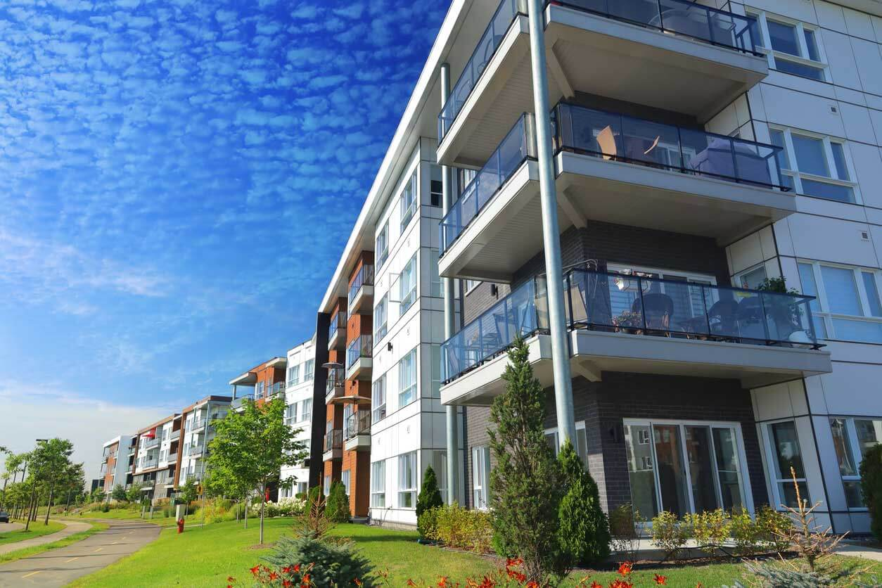large modern condo building with balconies - top provider of condominium insurance in maine and nh