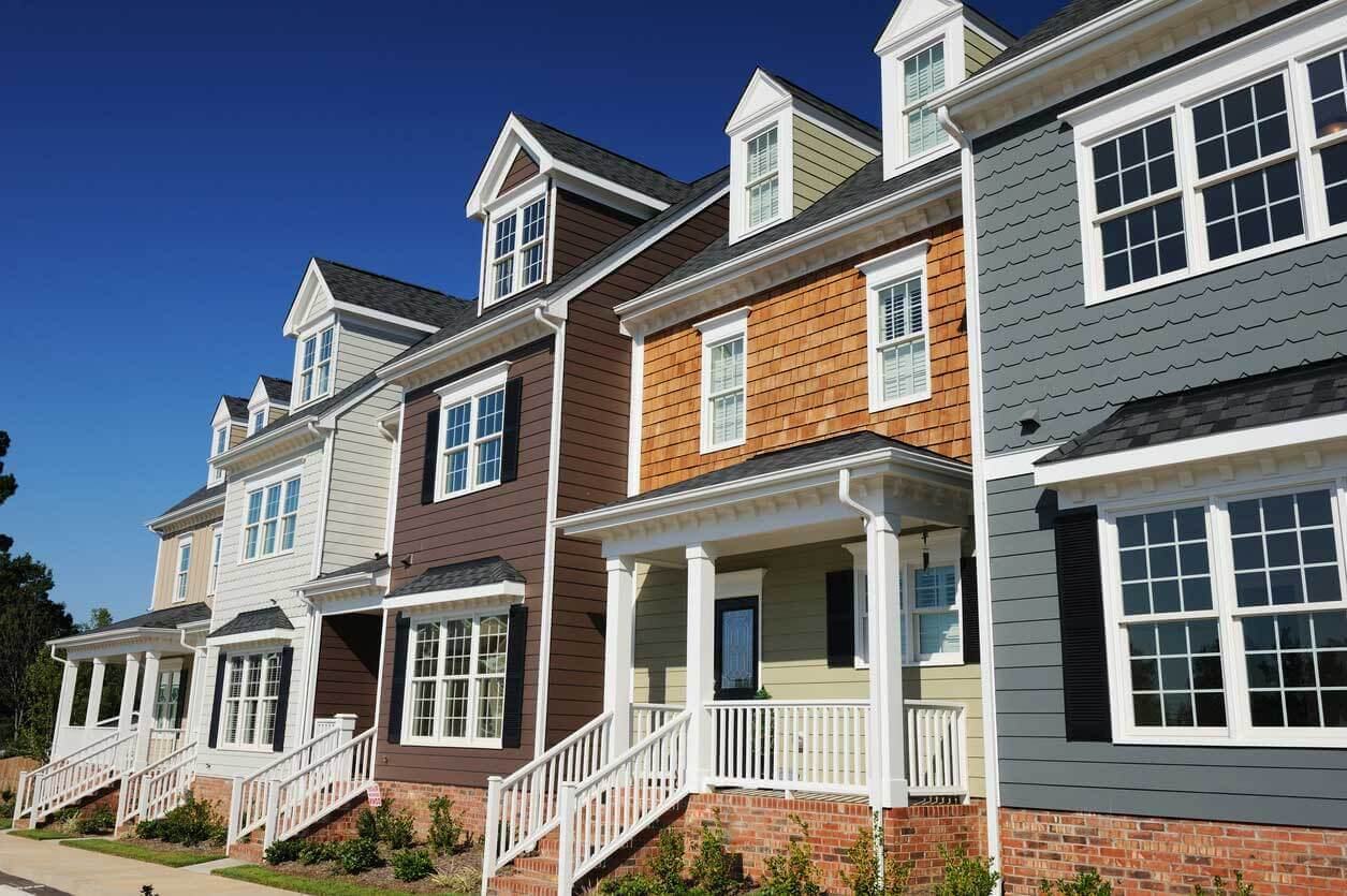 row of condos with front porches - top provider of condominium insurance in maine and nh